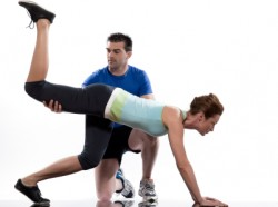 Queens Personal Trainer Helping a Client
